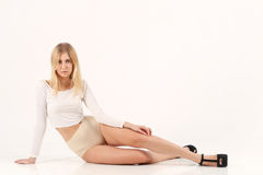 Blonde girl sit on the floor Stock Photography