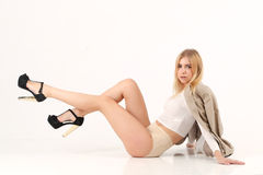 Blonde girl sit on the floor Royalty Free Stock Photo