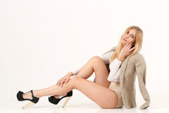 Blonde girl sit on the floor Royalty Free Stock Images