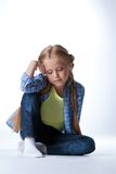 Blonde girl sitting on  floor Royalty Free Stock Photography