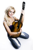 Blonde Girl sitting with guitar Royalty Free Stock Photo