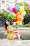Girl with a lot of ballons in hand stock photos