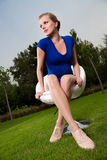 Blonde girl sitting on a swivel chair Royalty Free Stock Photo
