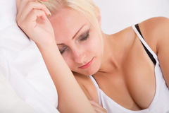Blonde girl sleeping in bed Royalty Free Stock Images