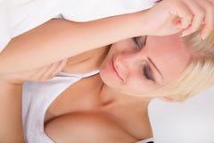 Blonde girl sleeping in bed Stock Photo