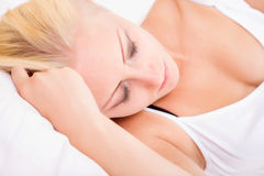Blonde girl sleeping in bed Stock Images