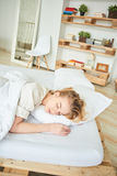 Blonde girl sleeps on a bed Royalty Free Stock Photo