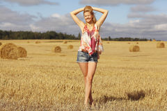 Blonde girl in sloping field Stock Photos