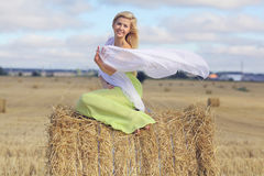 Blonde girl in sloping field Royalty Free Stock Photos