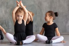 Girls stretch before a ballet stock photo