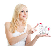 Blonde girl with small shopping cart Stock Photos