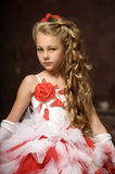 Blonde girl in a smart dress Royalty Free Stock Image