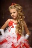 Blonde girl in a smart dress Stock Photos
