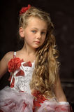 Blonde girl in a smart dress Stock Photography