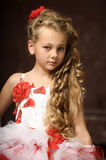 Blonde girl in a smart dress Royalty Free Stock Images