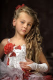 Blonde girl in a smart dress Stock Photo