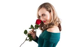 Blonde girl smelling rose Stock Images