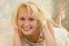 Blonde girl smiling Royalty Free Stock Images