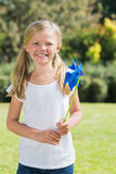 Blonde girl smiling and holding pinwheel Stock Photography