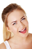 Blonde girl smiling with open mouth. Royalty Free Stock Image