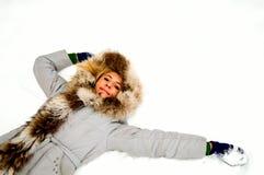 Blonde girl on snow stock photo