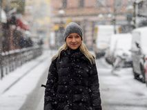 Blonde girl in the snow. A bonde girl in the snow Royalty Free Stock Image