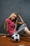 Blonde girl with soccer ball Royalty Free Stock Images