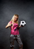 Blonde girl with soccer ball Stock Images