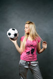 Blonde girl with soccer ball Stock Photography