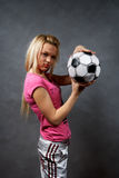 Blonde girl with soccer ball. Beautiful young blonde girl with soccer ball Royalty Free Stock Image