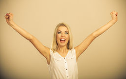 Blonde girl spreading hands with joy, Stock Photo