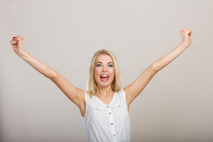 Blonde girl spreading hands with joy, Stock Image