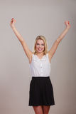 Blonde girl spreading hands with joy, Royalty Free Stock Photo