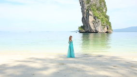 Blonde Girl Stand on Beach against Tranquil Transparent Azure Sea stock footage