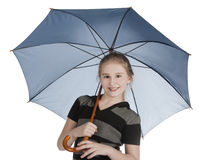 Blonde girl standing and holding blue umbrella Royalty Free Stock Image