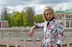 Blonde girl standing of an old palace Royalty Free Stock Photos