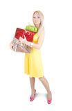 Blonde girl standing with present boxes Royalty Free Stock Images