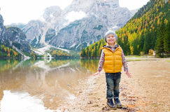 Blonde girl standing on the shore of Lake Bries Royalty Free Stock Photos