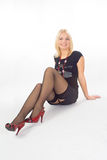 Blonde girl in stockings Stock Photos