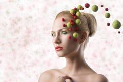 Blonde girl with strage make-up Royalty Free Stock Image