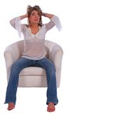 Blonde Girl Stress And Confuse. Isolated beautfitul blonde girl sit on nice sofa, holding her head looked very stressful and confused Royalty Free Stock Image