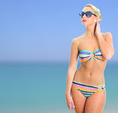 Blonde girl in striped bikini Stock Photos
