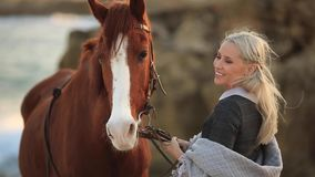 Blonde girl stroking a horse stock video footage