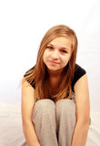 Blonde girl in studio setting. A beautiful blonde haired teenage girl in studio setting stock image