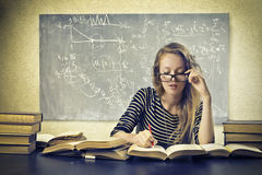 Blonde Girl Studying. In a classroom royalty free stock image