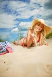 Blonde girl on the summer beach Stock Photos