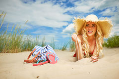 Blonde girl on the summer beach Royalty Free Stock Images