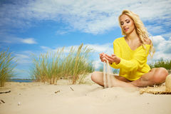Blonde girl on the summer beach Stock Photo
