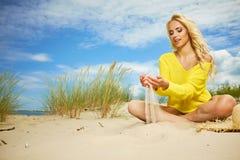 Blonde girl on the summer beach Stock Photo