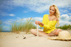 Blonde girl on the summer beach Stock Images